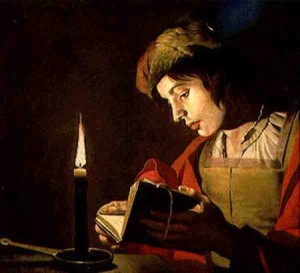 young_man_reading_candle_ligh_hi