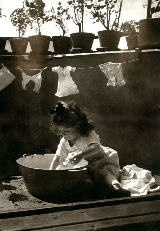 girl washing dolls clothes
