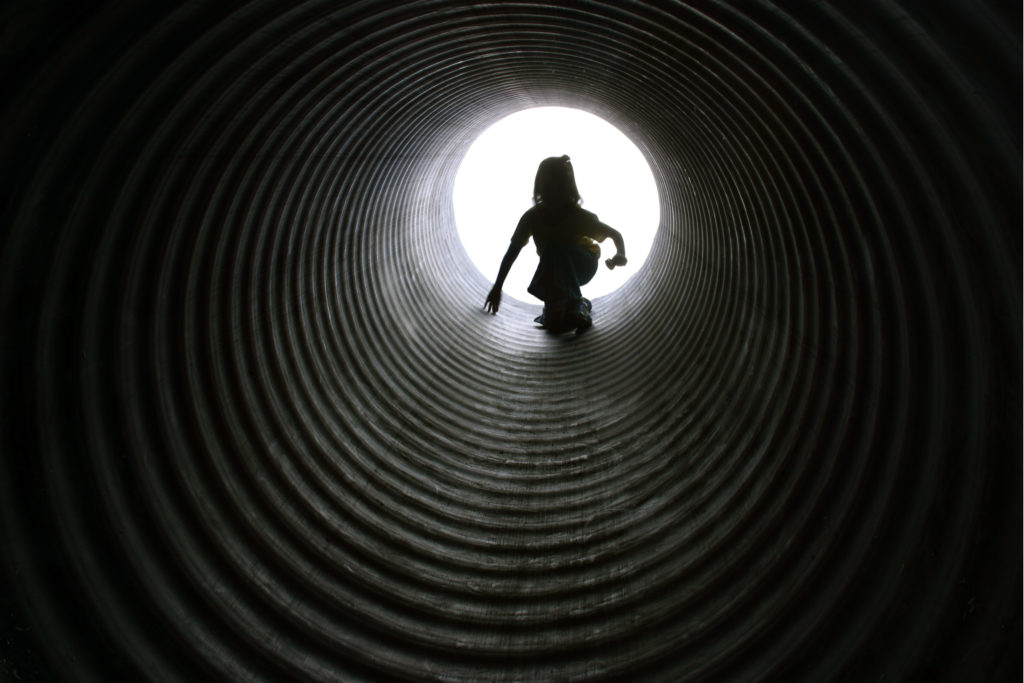 child in tunnel for childhood trauma post